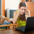 Sorehead mother with baby using laptop — Stock Photo #46913115