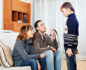 Mother and  father with belt scolding  son   — Stock Photo