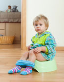 Toddler sitting on green potty   — Stock Photo