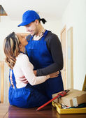 Service man and woman having flirt — Stock Photo