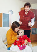 Giving medicament to unwell baby — Stock Photo
