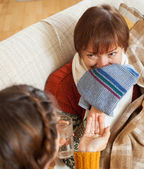 Daughter caring for sick mature mother has cough — Stock Photo