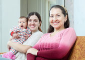 Mature woman and young mother with baby — ストック写真