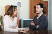Serious man with wife talking — Stock Photo