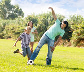 Couple and teenager playing  at  park — Stock Photo