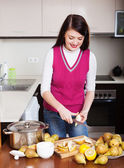 Woman cooking pear jam   — Stock Photo