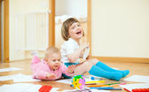 Cheerful sibling plays in home — Stock Photo