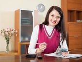Happy brunette girl with money and documents    — Stock Photo