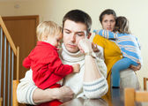 Ordinary young sad  family of four after quarrel  — Stock Photo