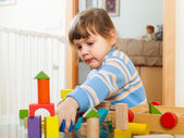 Serious 3 years child playing with toys   — Stock Photo