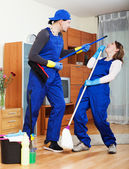 Playful cleaning team in uniform — Stock Photo