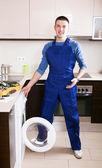 Service worker repairing washing machine — Stock Photo
