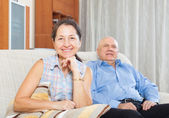 Happy mature woman against elderly man — Stockfoto