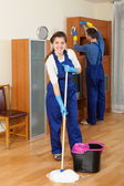 Cleaners team cleaning in room — Stock Photo