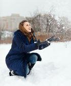 Happy girl throwing  snowflakes i — Stock Photo