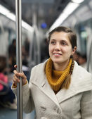 Female passenger in subway train — Stock Photo