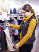 woman choosing skirt at  store — Stock Photo
