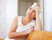 Mature woman uses handkerchief on  head   — Stock Photo