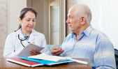 Mature doctor and senior patient — Stock Photo