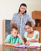 Family doing homework  — Stock Photo