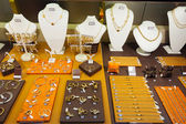 Gold jewelry at showcase — Stock Photo