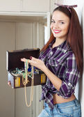 Happy housewife with treasure chest — Stock Photo