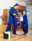 Playful housecleaners — Stock Photo