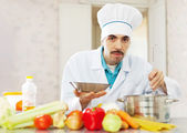 caucasian cook cooking with ladle   — Stock Photo