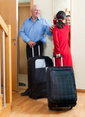 Senior couple leaving the home — Photo