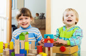 happy children playing with blocks  in home   — Stock Photo