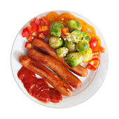 Top view of sausages with vegetables   — Stock Photo
