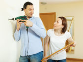 Man and woman  hanging  art picture — Stock Photo