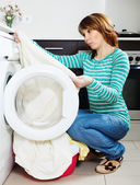 Woman doing laundry with washing machine — Stock Photo