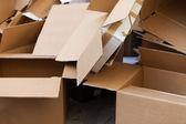 Cardboard boxes in trash — Stock Photo