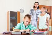 Teenager schoolboy doing homework — Stock Photo