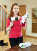Happy woman in red warming shoes — Foto Stock