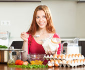 Housewife  in home kitchen — Stock Photo