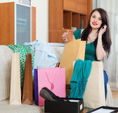 Woman  with shopping bags speaking by mobile — Stock Photo