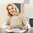 Woman filling in paper — Stock Photo #47097965
