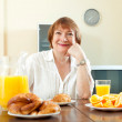 Mature  woman having breakfast — Stock Photo #47098379