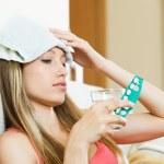 Girl suffering from headache — Stock Photo #47098617