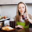 Blonde woman drinking kvass from glass — Stock Photo #47098721