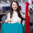 Brunette woman choosing clothes at store — Stock Photo
