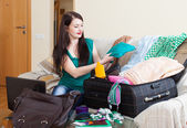 Female traveler packing suitcase for holiday — Stock Photo