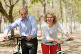Aged couple with bicycles — Stock Photo