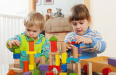 Two  tranquil children playing with wooden toys  — Stock Photo