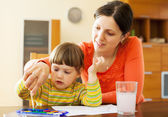 Mother and her child painting — Stock Photo