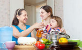 Women with child cook — Stock Photo