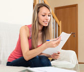 Girl freelancer working with documents  — Stock Photo