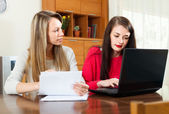 Two women works with financial documents — Stock Photo